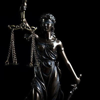 law-and-justice-symbols-on-dark-background-micha-chodyra